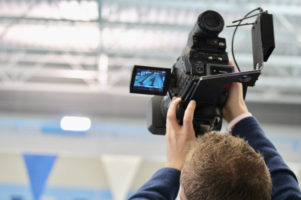 News camera capturing TYR Pro Swim Series Media Day